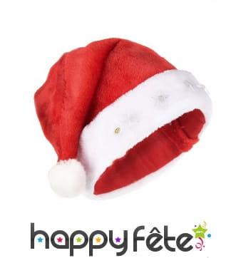 Bonnet rouge de père Noël avec étoiles lumineuses