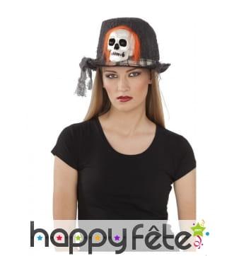 Chapeau noir avec crâne aux cheveux oranges
