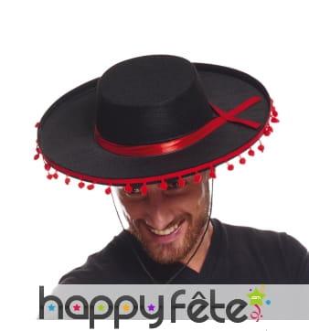 Chapeau traditionnel espagnol avec pompons rouges