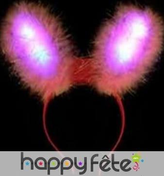Oreilles de lapin rose lumineuses sur serre tête