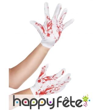 Paire de gants blancs courts ensanglantés
