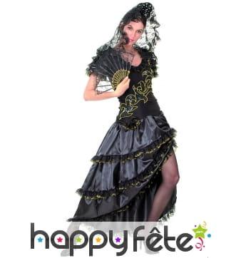 Robe noire et dorée de danseuse de flamenco