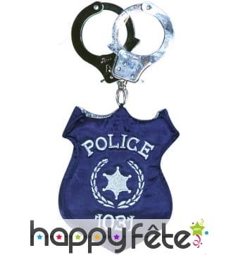Sac à main menottes et badge de policier