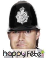 Casque de policier anglais noir avec insigne