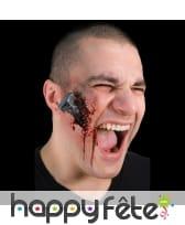 Postiche boulon enfoncé dans la peau