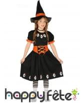 Robe noire de petite sorcière avec crânes rigolos