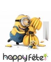 Silhouette de Minons avec régime de bananes
