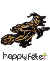 Sorcière noire et dorée sur son balais 58cm